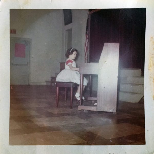 Teresa playing at a recital as a child